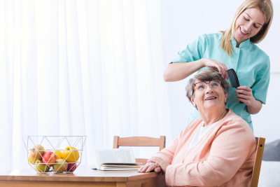 caregiver combing her patient hair