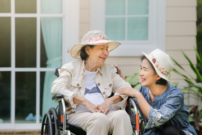 caregiver and senior woman enjoying the mornig breeze